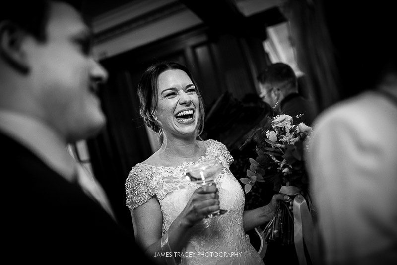 bride laughing at eaves hall