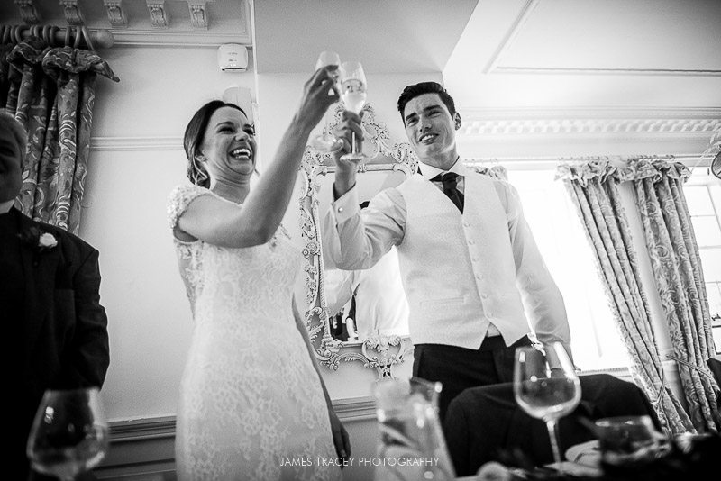toasting the bride at eaves hall wedding