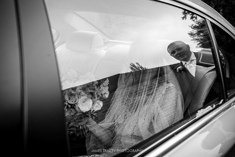 bride in wedding car