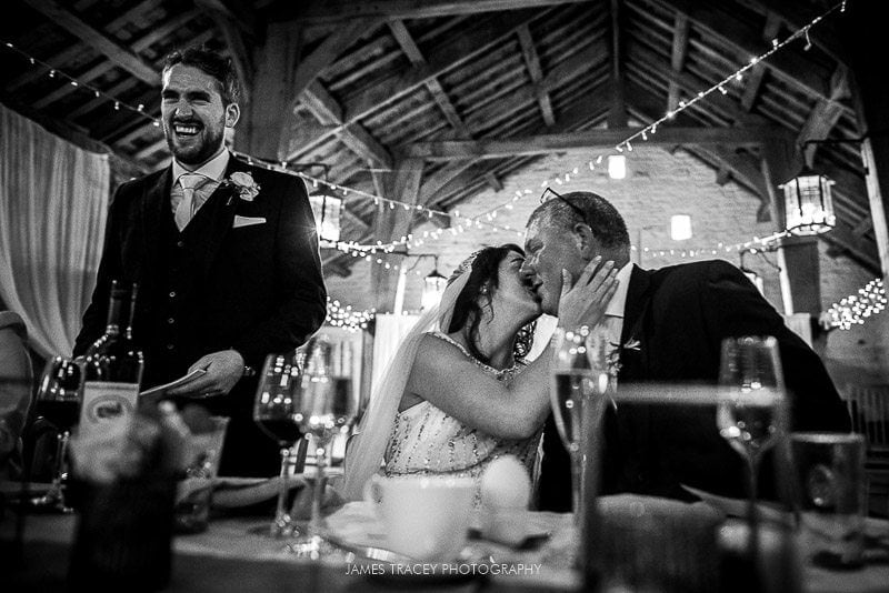 bride kissing her dad