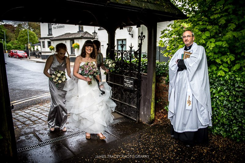 bride walking to church in didsbury