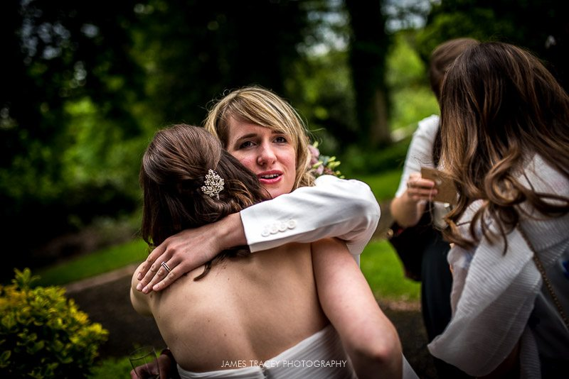 friend hugging the bride