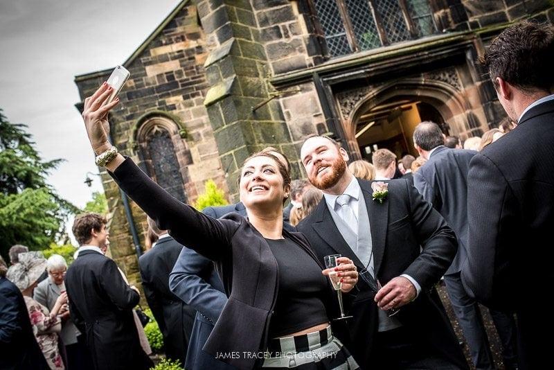 groom having a selfie