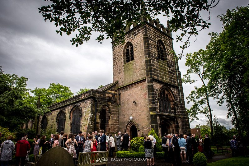 wedding guests outside church in didsbury