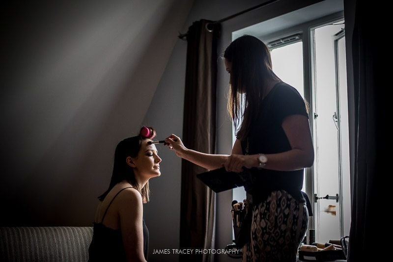 bride having make up applied