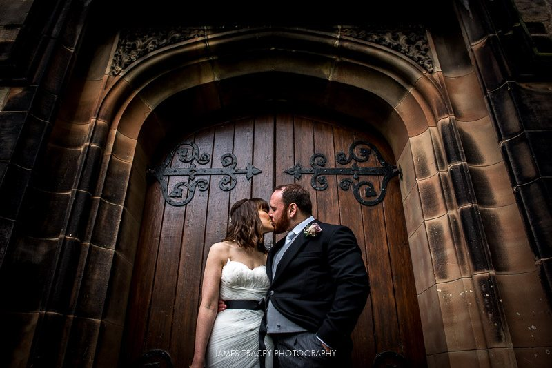 bride and groom kissing in front of a doot