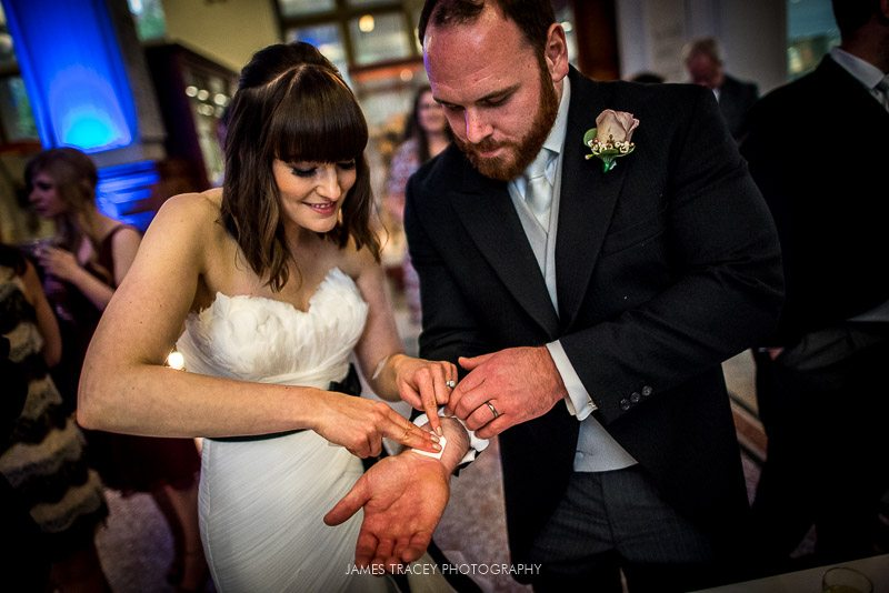 bride and groom putting tattoos on