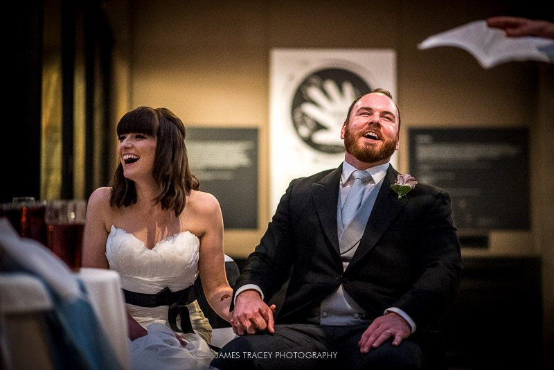 bride and groom laughing at best men