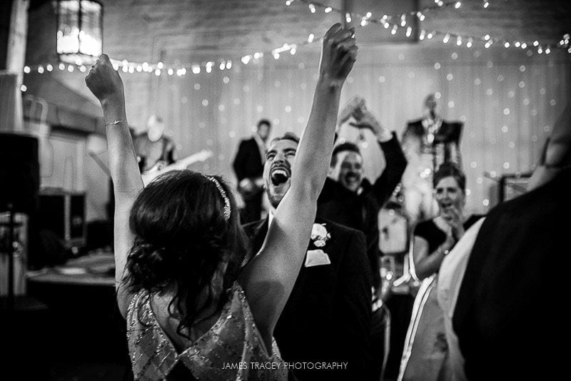 cheers at wedding reception