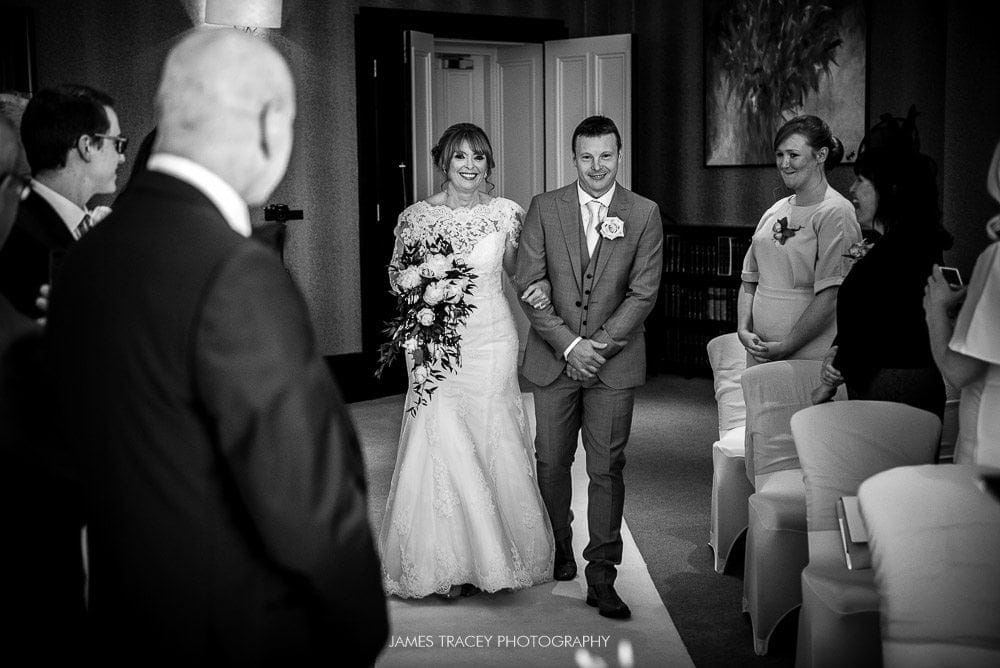 bride walking up the aisle at chester grosvenor