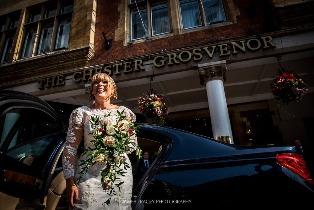 bride getting out of car outside chester grosvenor