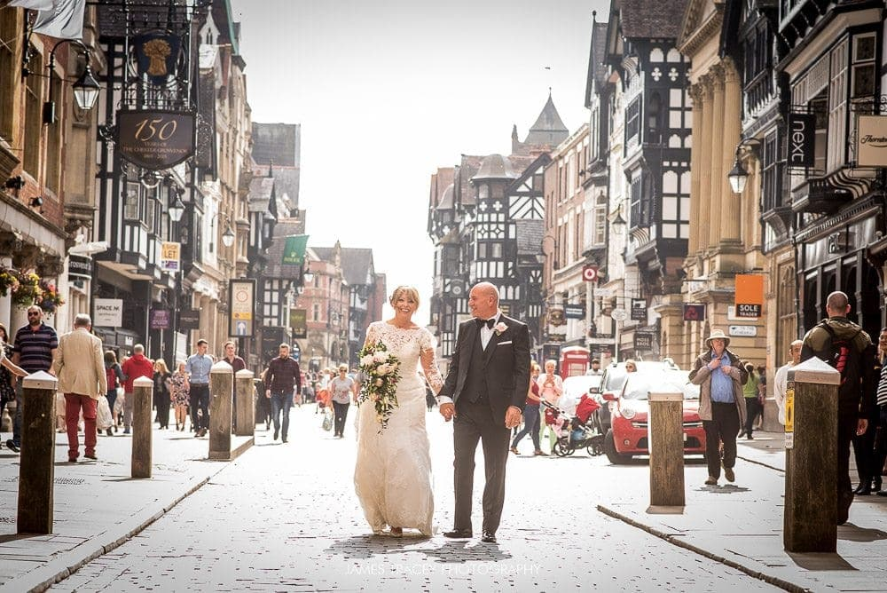 bride and groom in the streets of chester