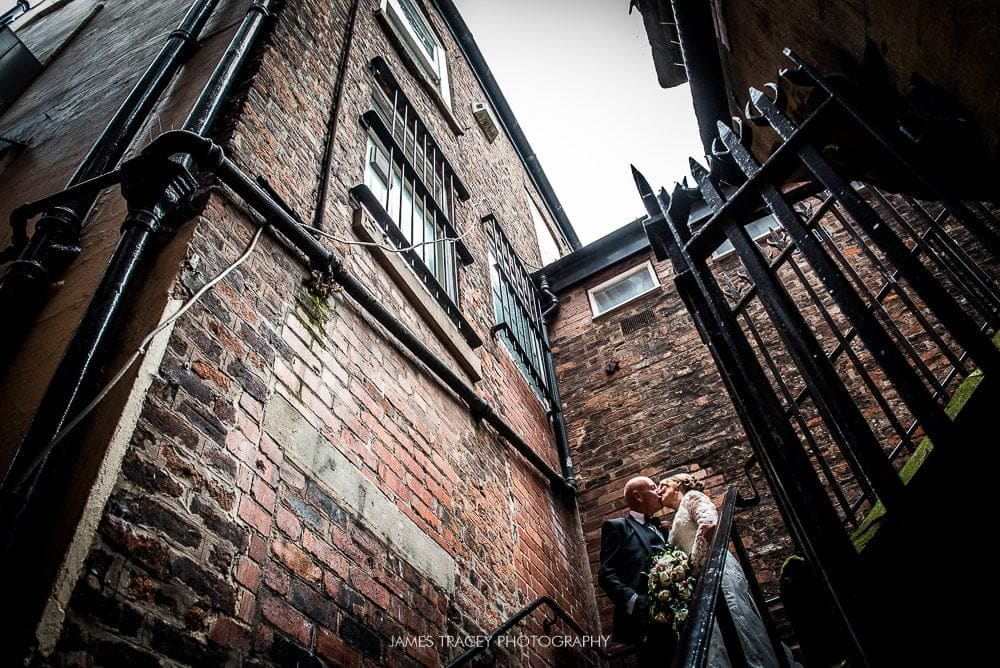 bride and groom in a backstreet in chester