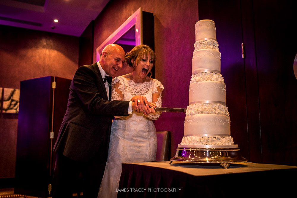 cutting wedding cake at chester grosvenor