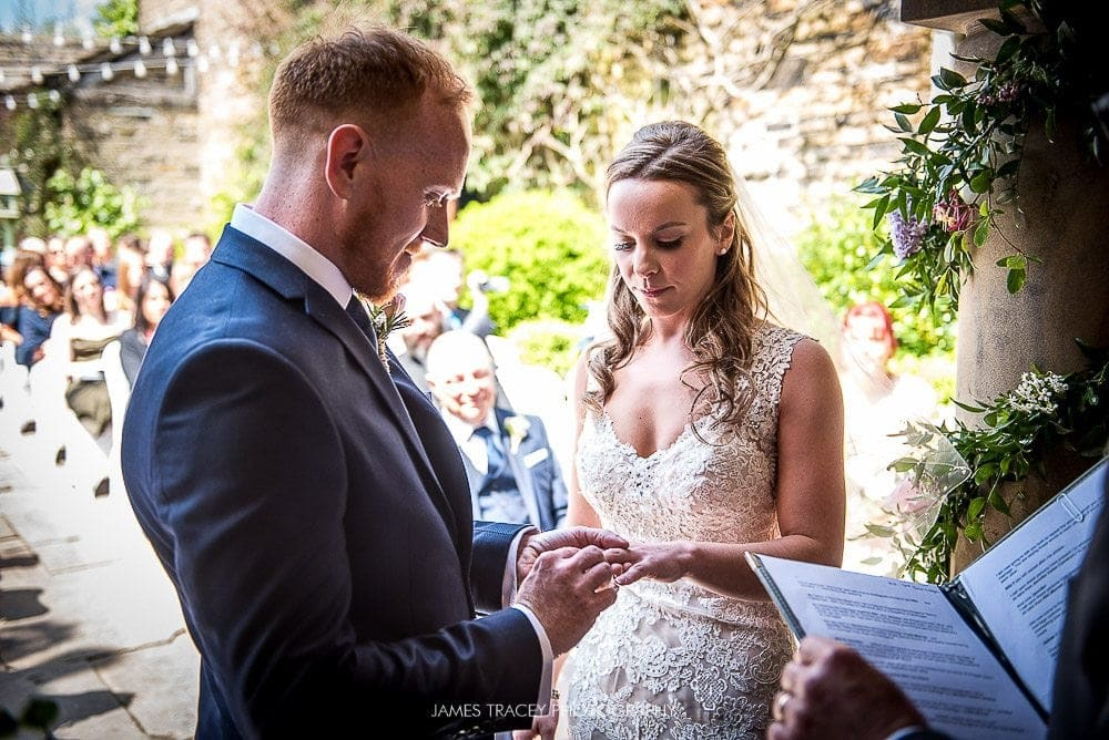 exchange of wedding rings at holdsworth house in halifax