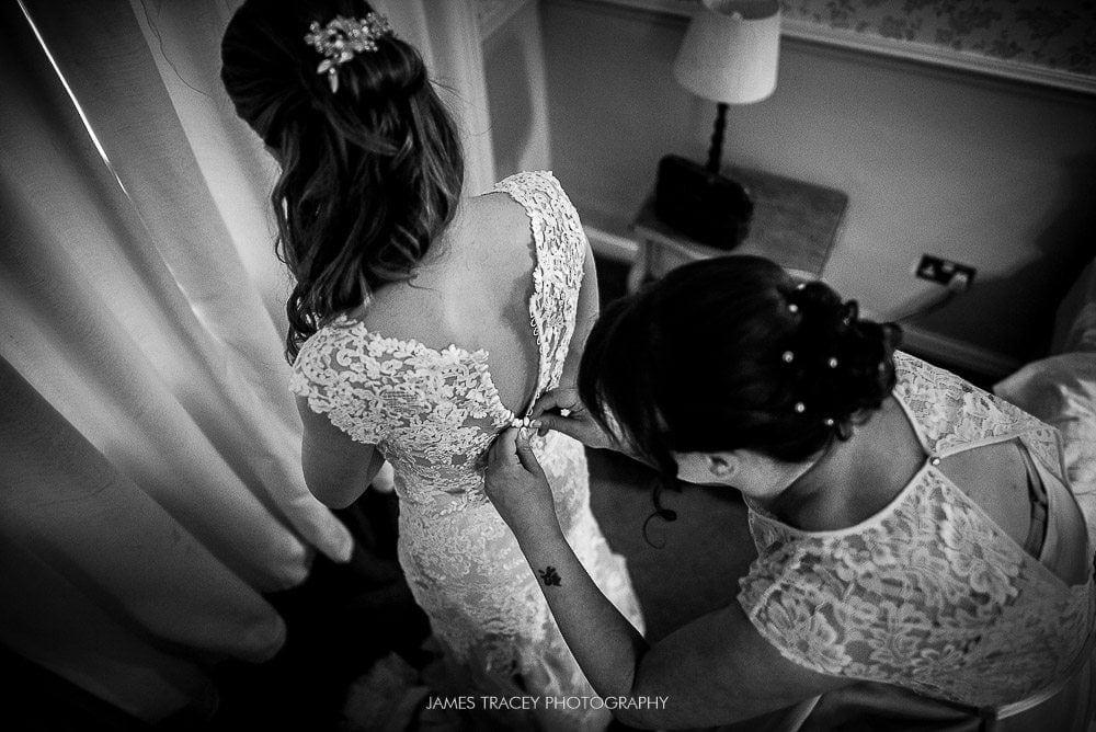 wedding dress being put on