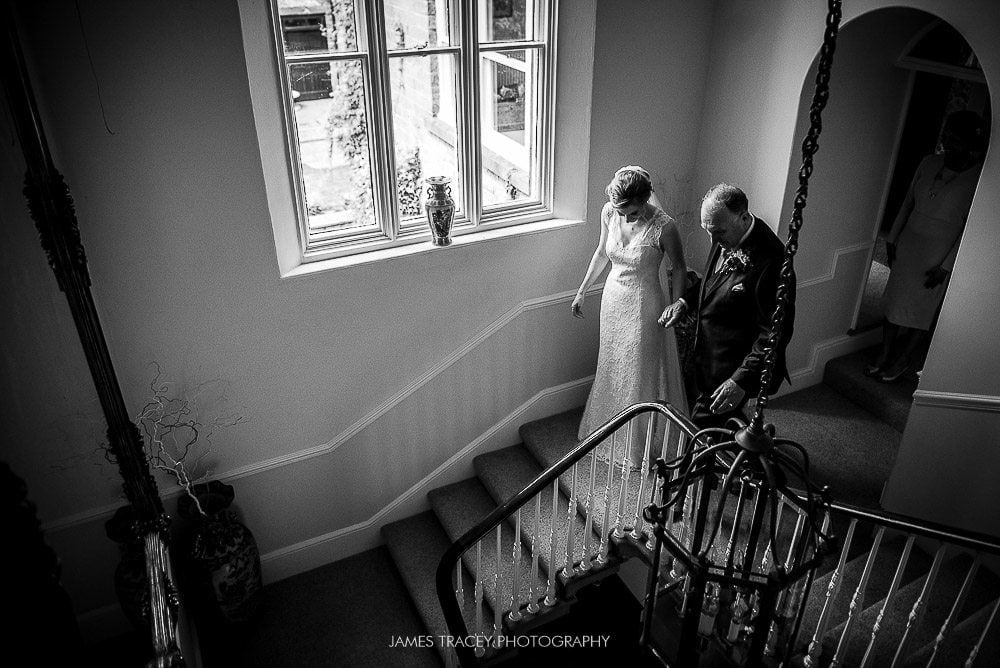 walking to wedding down stairs