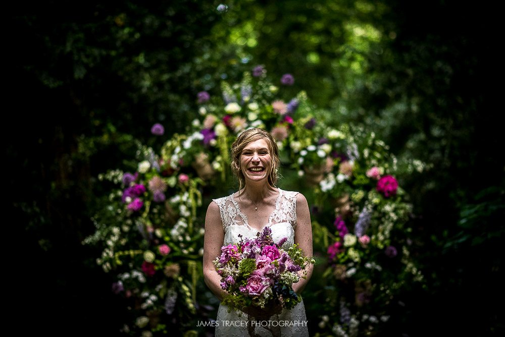 bride and her floral arch