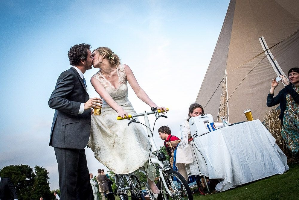 wedding couple kissing on a bike