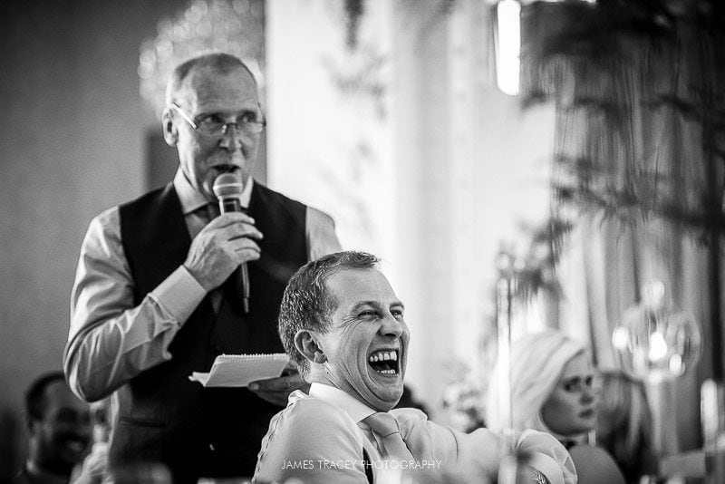 father of the bride with laughing groom