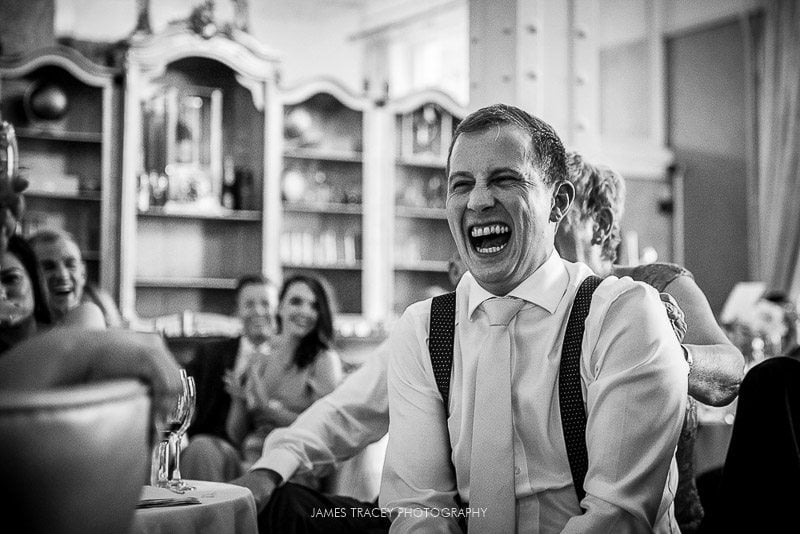 groom laughing loudly