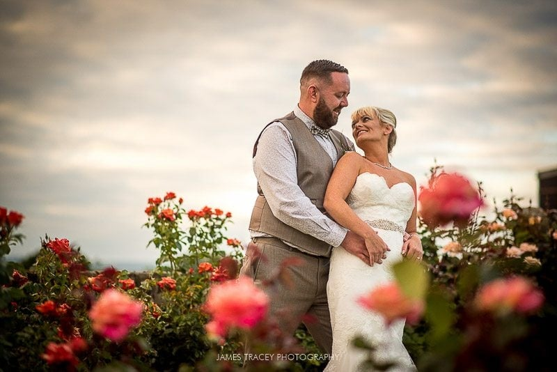bride and groom in flowers