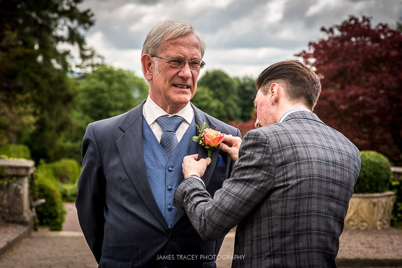 fatherof the bride having flower added