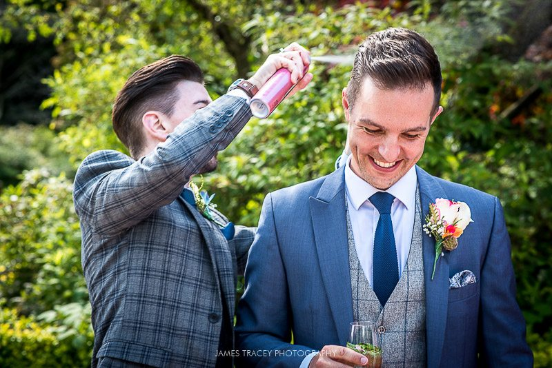 groom having his hair sprayed