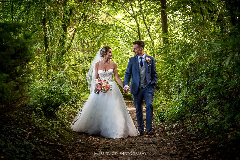 wedding couple in eaves hall gardens