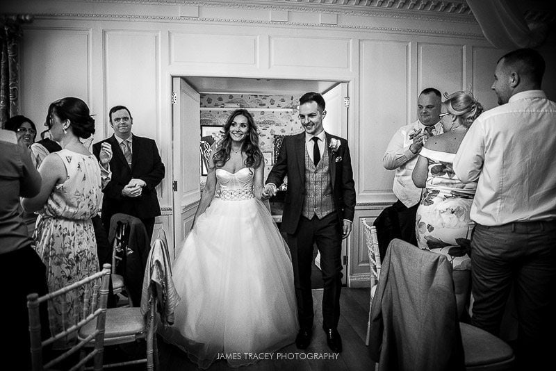bride and groom walking into wedding breakfast