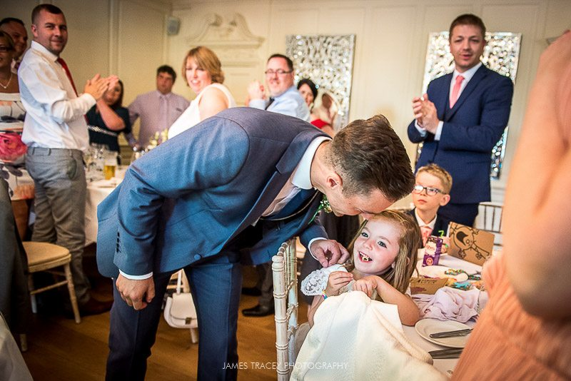 groom kissing small child