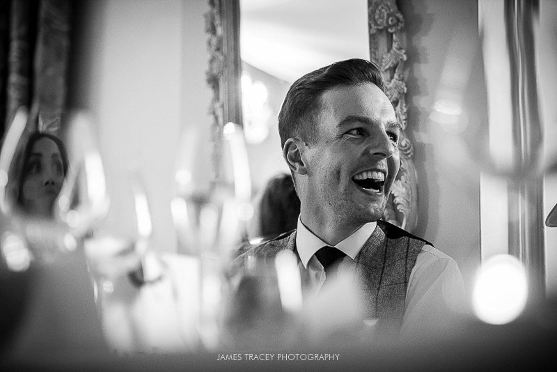 groom laughing at best man