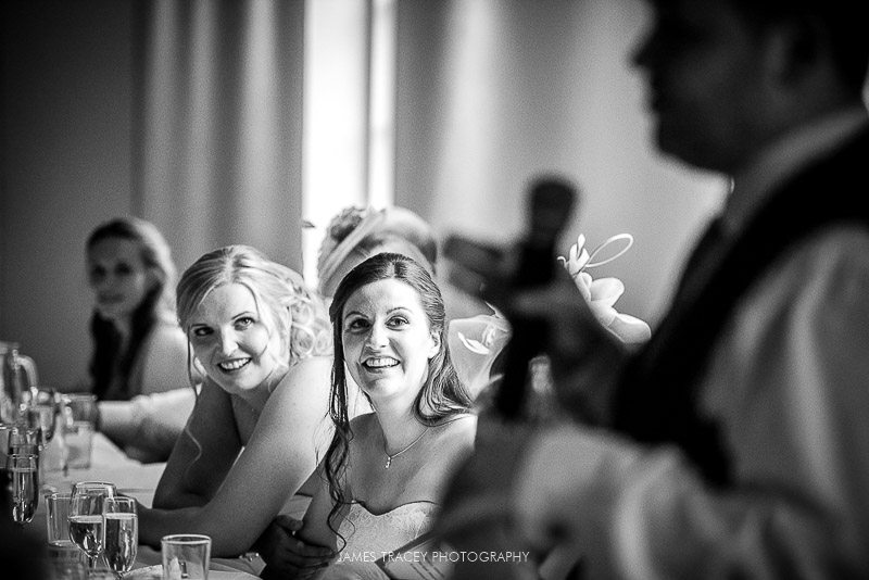 bride laughing at best man