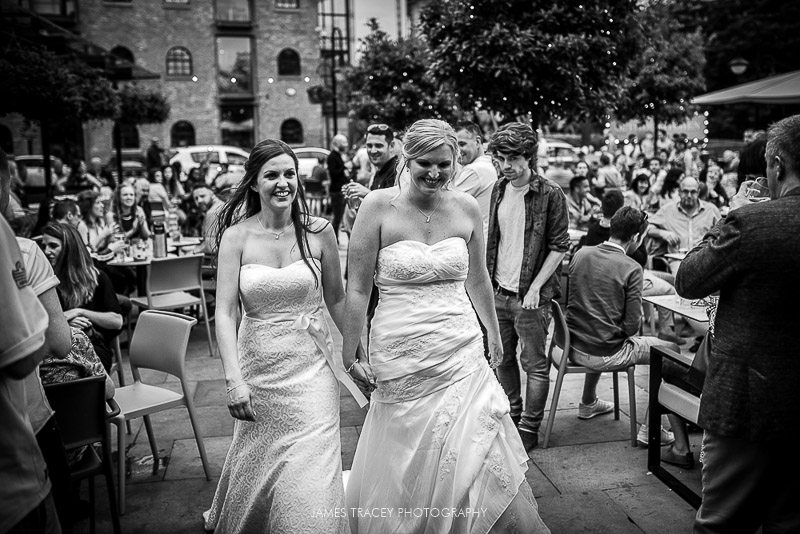two brides being cheered