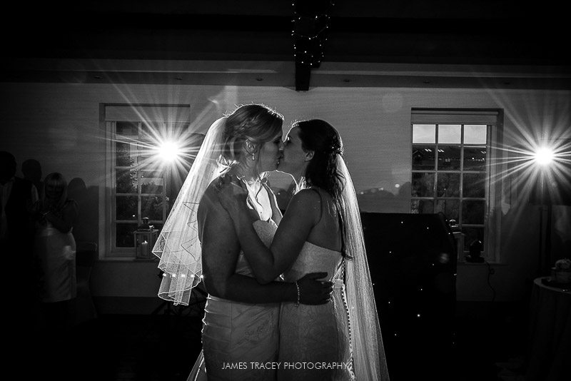 bride and bride kissing
