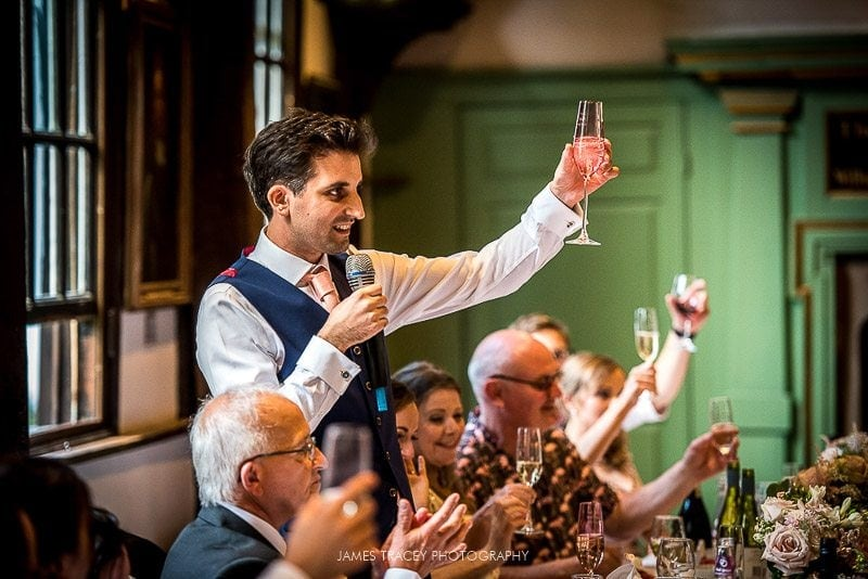 groom toasting wedding guests