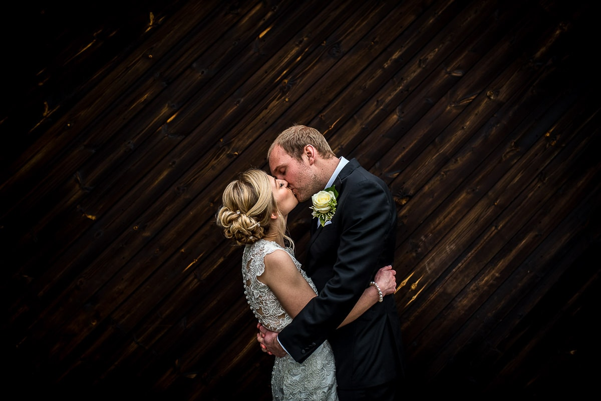 wedding couple kissing at colshaw hall