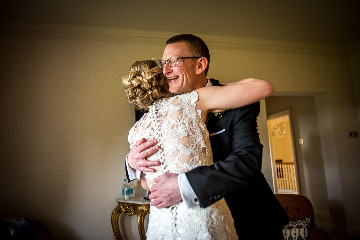 father of the bride hugging his duaghter at colshaw hall