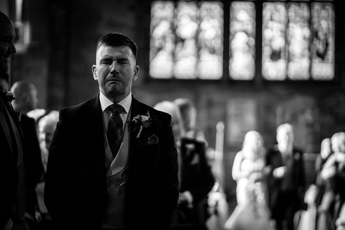 groom holding tears in at wedding