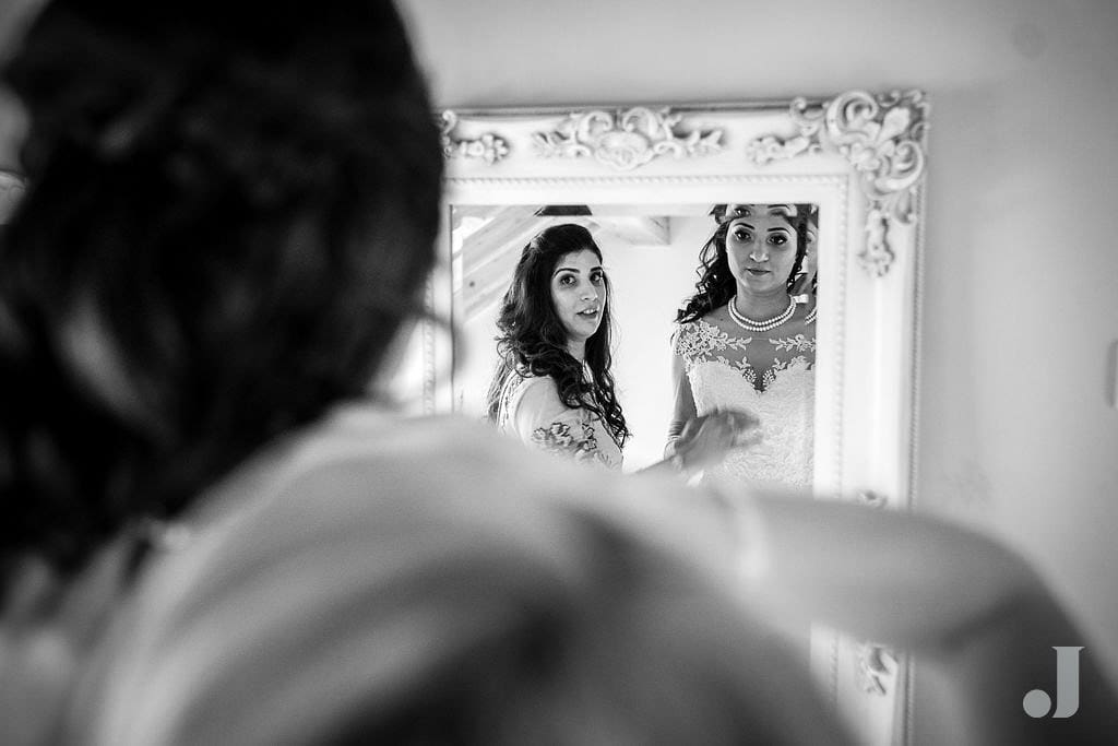 bride in a mirror at oak tree of peover