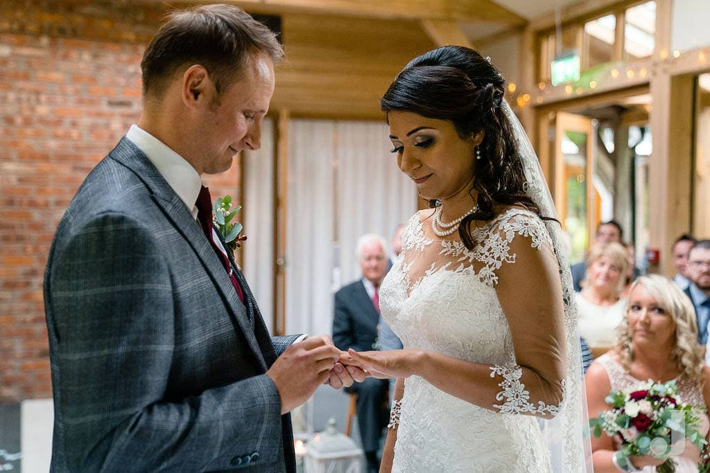 exchange of wedding rings at oak tree of peover