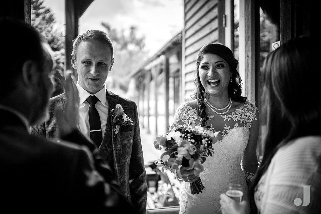 laughing wedding couple at oak tree of peover