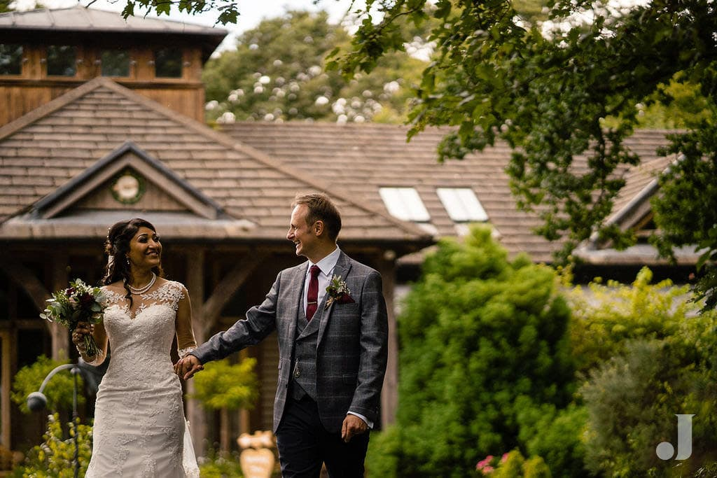 bride and groom in front of oak tree of peover
