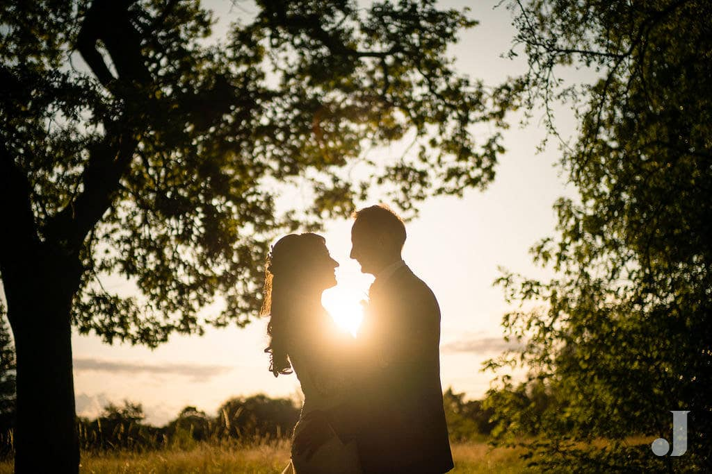 wedding couple at sunset outside oak tree of peover