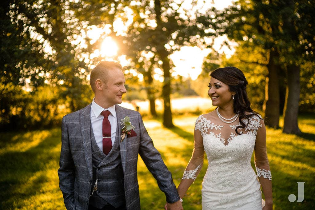 happy weddng couple at oak tree of peover