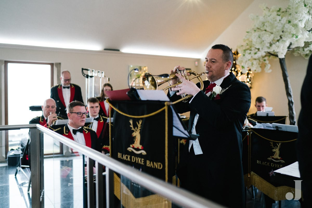 Black Dyke brass band performing at The Saddleworth Hotel