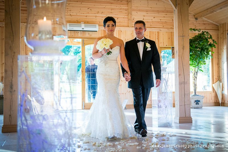 bride walking up the aisle at Colshaw Hall in Cheshire