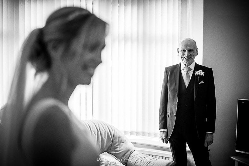 father of the bride seeing his daughter for the first time wedding at the plough inn at hathersage