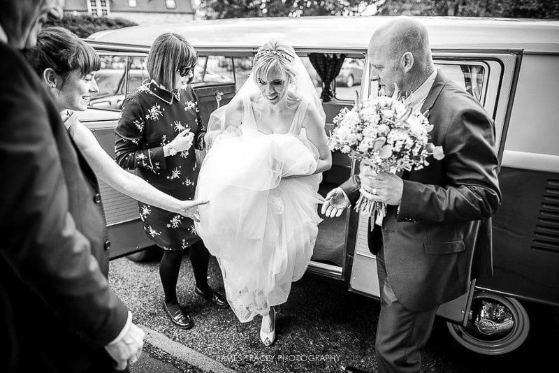 bride getting out of a camper van before her hathersage wedding
