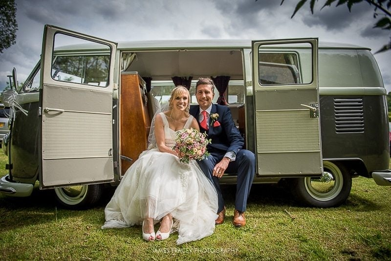 bride and groom sat in a camper van plough inn hathersage wedding photography